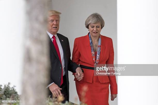 British Prime Minister Theresa May and US President Donald Trump walk along The Colonnade of the West Wing at The White House on January 27 2017 in...
