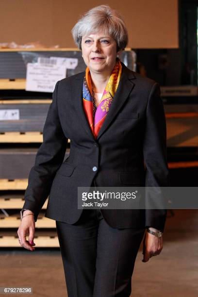 British Prime Minister Theresa May arrives to address the media following a tour of the Octink sign manufacturers' factory on May 5 2017 in Brentford...
