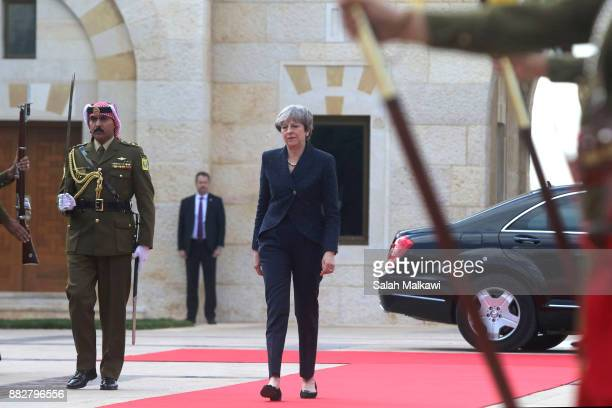 British Prime Minister Theresa May arrives to attend a bilateral meeting with King Abdullah II of Jordan at the Royal Palace on November 30 2017 in...