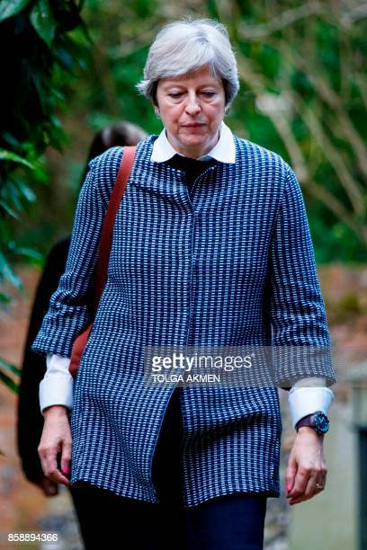 British Prime Minister Theresa May arrives to attend the Sunday morning service at a church in her Maidenhead constituency in Berkshire east of...