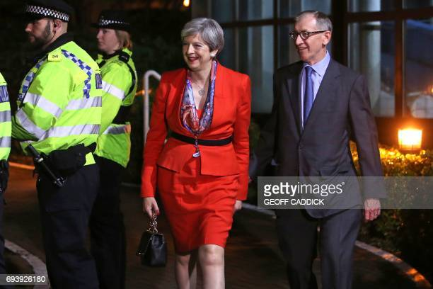 British Prime Minister Theresa May arrives with her husband Philip at the count centre in Maidenhead early in the morning of June 9 hours after the...