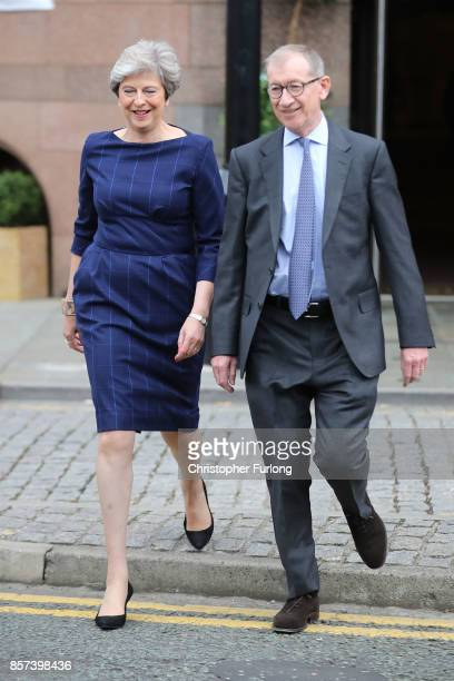 British Prime Minister Theresa May arrives with husband Philip to deliver her keynote speech to delegates and party members on the last day of the...