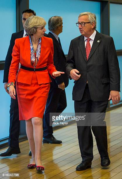 British Prime Minister Theresa May arrives with President of the European Commission JeanClaude Juncker at the European Commission at the end of a...