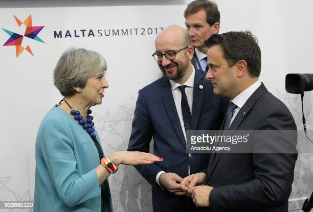 British Prime Minister Theresa May Belgian Prime Minister Charles Michel and Prime Minister of Luxembourg Xavier Bettel chat during an informal...
