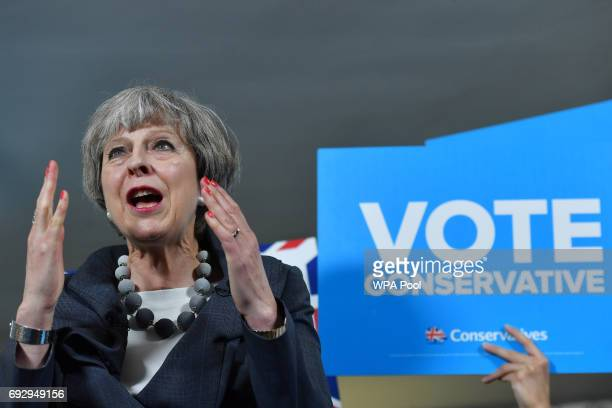 British Prime Minister Theresa May delivers a speech during an election campaign visit to Langton Rugby Club on June 6 2017 StokeonTrent England...