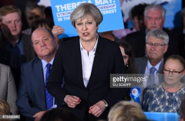 British Prime Minister Theresa May delivers a speech to Conservative party supporters in Mawdesley Village Hall near Ormskirk in north west England...