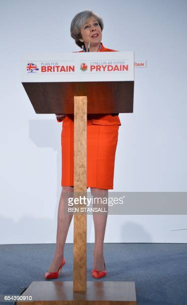British Prime Minister Theresa May delivers her address to delegates at the Conservative Party Spring Conference in Cardiff south Wales on March 17...