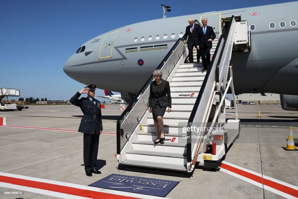 British Prime Minister, Theresa May flanked by Foreign Secretary, Boris Johnson and Defence Secretary Sir Michael Fallon arrive to attend a NATO summit meeting on May 25, 2017 in Brussels, Belgium. The North Atlantic Treaty Organisation (NATO) is made up of 28 countries. This year's summit is held at their new headquarters in Brussels. The US President Donald Trump will meet other leaders to discuss NATO taking a greater role in the fight against ISIS.