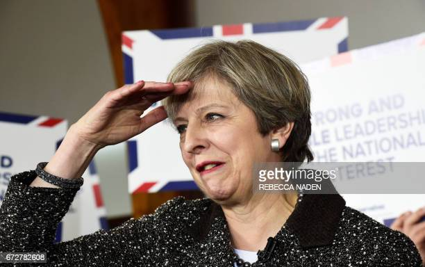 British Prime Minister Theresa May gestures as she speaks to supporters at the Brackla community centre in Bridgend south Wales on April 25 in the...