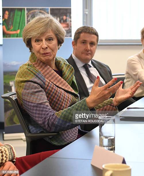 British Prime Minister Theresa May gestures during a meeting with local business leaders at SkiTech Daresbury in Warrington north west England on...
