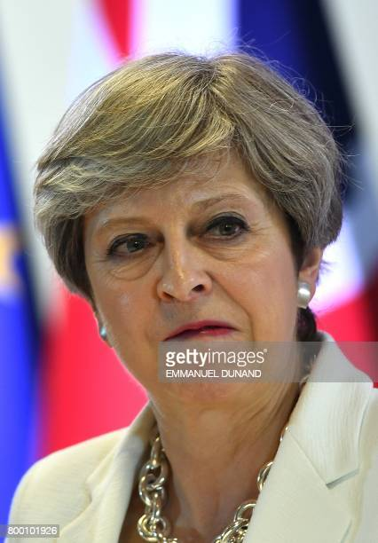 British Prime Minister Theresa May gives a press conference at the end of a European Council in Brussels June 23 2017 / AFP PHOTO / EMMANUEL DUNAND