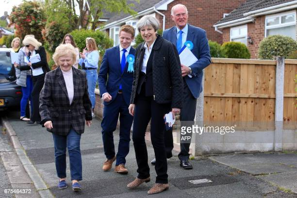 British Prime Minister Theresa May goes house to house Ormskirk in north west England on May 1 2017 as campaigning continues in the build up to the...