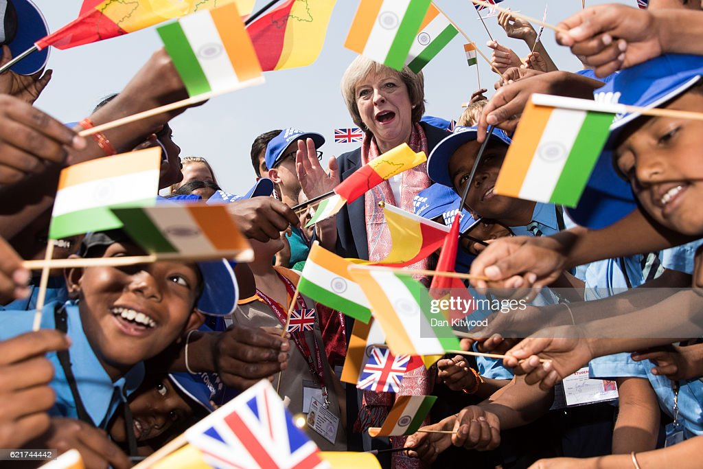 British Prime Minister Theresa May greets children at Stonehill Government Primary School on November 8, 2016 in Bangalore, India. Mrs May is in India on a two day trade mission to reconnect the UK with the Commonwealth during her first trip since taking office. Yesterday the Prime Minister met with Indian Prime Minister Narendra Modi.