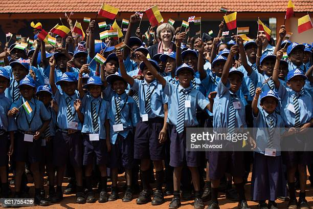 British Prime Minister Theresa May greets children at Stonehill Government Primary School on November 8 2016 in Bangalore India Mrs May is in India...
