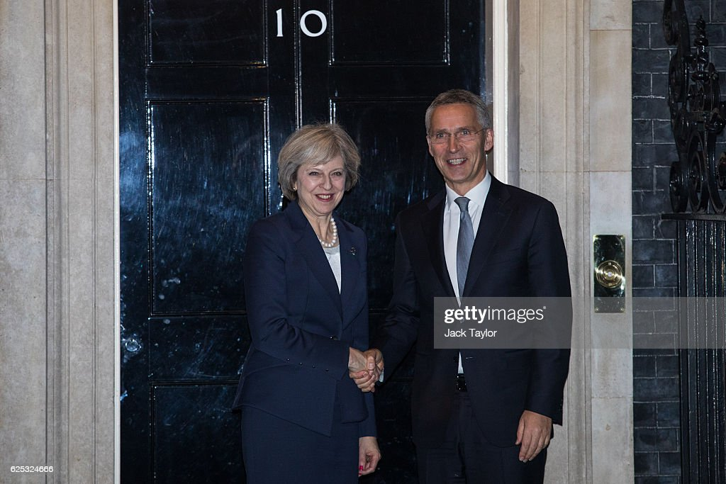 British Prime Minister Theresa May (L) greets Secretary General of NATO Jens Stoltenberg (R) outside 10 Downing Street on November 23, 2016 in London, England. This is Theresa May's first meeting with the NATO head since Donald Trump was elected US President. During his campaign Trump suggested he may not come to the aid of other NATO members in the event of an attack. Britain has previously expressed concern at other NATO members not spending the required two per cent of their GDP on defence.