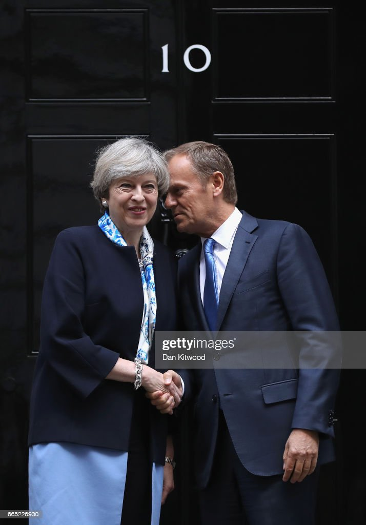 British Prime Minister, Theresa May, greets The President of the European Council, Donald Tusk, on the doorstep of 10 Downing Street on April 6, 2017 in London, England. Donald Tusk is meeting Theresa May ahead of the EU27 leaders' meeting on Brexit on April 29, 2017 in Brussels.