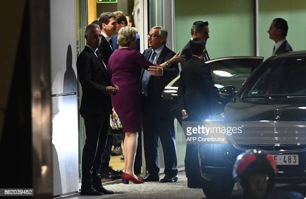 TOPSHOT British Prime Minister Theresa May hugs European Commission President JeanClaude Juncker after a meeting at the European Commission in...