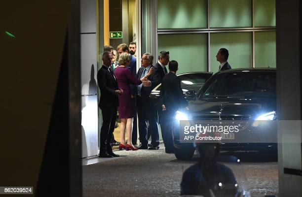 British Prime Minister Theresa May hugs European Commission President JeanClaude Juncker after a meeting at the European Commission in Brussels on...