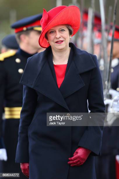 British Prime Minister Theresa May inspects the Officer Cadets during the Sovereign's Parade at Royal Military Academy Sandhurst on April 13 2017 in...
