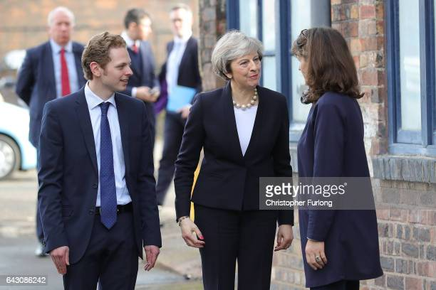 British Prime Minister Theresa May is greeted by Emma Bridgewater and Stoke Central byelection candidate Jack Brereton as she arrives at the Emma...