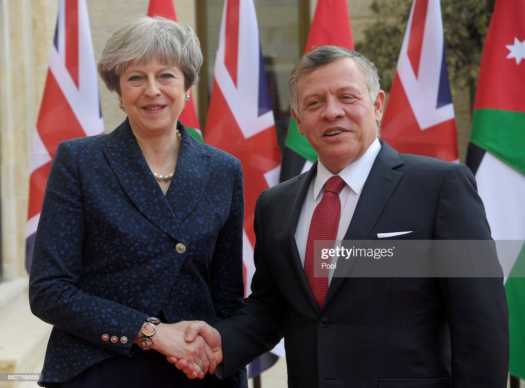 British Prime Minister Theresa May is greeted by King Abdullah II of Jordan as she arrives to attend a bilateral meeting at the Royal Palace on November 30, 2017 in Amman, Jordan. Theresa May has visited Iraq, Saudi Arabia and Jordan during her diplomatic tour of the region.