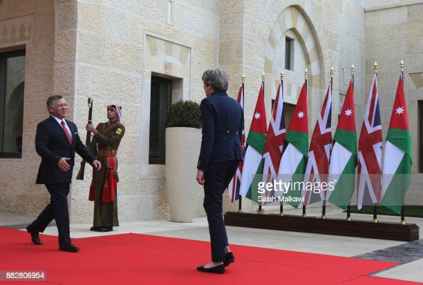 British Prime Minister Theresa May is greeted by King Abdullah II of Jordan as she arrives to attend a bilateral meeting at the Royal Palace on...