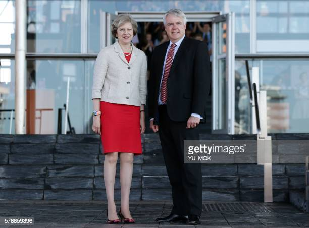 British Prime Minister Theresa May is greeted by the First Minister of Wales Carwyn Jones as she arrives for their meeting at the Senedd the National...