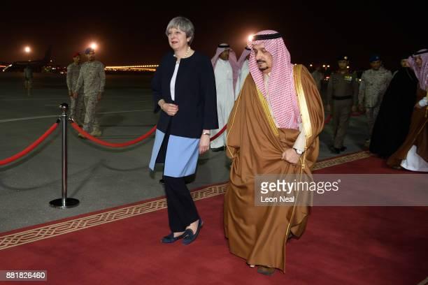 British Prime Minister Theresa May is greeted by the Governor of Riyadh Province Faisal bin Bandar Al Saud at King Abdul Aziz airport on November 29...