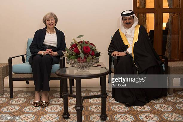 British Prime Minister Theresa May is greeted by the King of Bahrain Hamad bin Isa Al Khalifa at the royal family villa after her arrival in Bahrain...