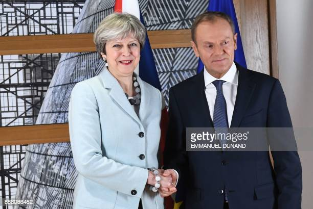 British Prime Minister Theresa May is welcomed by European Council President Donald Tusk at the European Council in Brussels on December 8 2017...