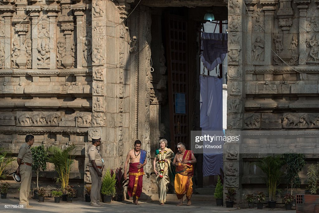 British Prime Minister Theresa May is welcomed to the Sri Someshwara Temple on November 8, 2016 in Bangalore, India. Mrs May is in India on a two day trade mission to reconnect the UK with the Commonwealth during her first trip since taking office. Yesterday the Prime Minister met with Indian Prime Minister Narendra Modi.