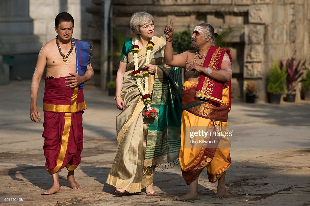 British Prime Minister Theresa May is welcomed to the Sri Someshwara Temple on November 8, 2016 in Bangalore, India. Mrs May is in India on a two-day trade mission to reconnect the UK with the Commonwealth during her first trip since taking office. Yesterday the Prime Minister met with Indian Prime Minister Narendra Modi.