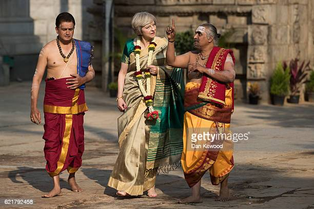 British Prime Minister Theresa May is welcomed to the Sri Someshwara Temple on November 8 2016 in Bangalore India Mrs May is in India on a twoday...