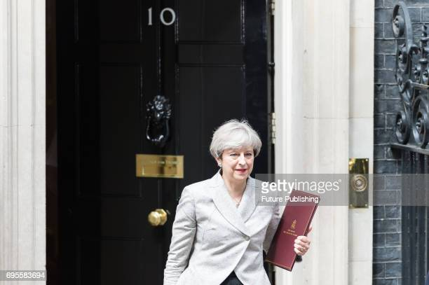 British Prime Minister Theresa May leaves 10 Downing Street after talks with DUP's leader Arlene Foster about an electoral pact on June 13 2017 in...