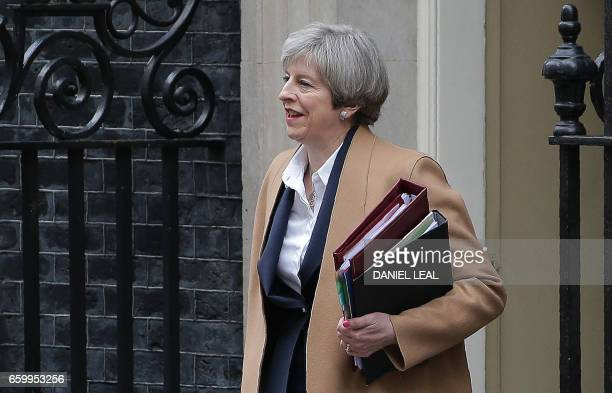 British Prime Minister Theresa May leaves 10 Downing Street before heading to the Houses of Parliament to attend the weekly Prime Minister's...
