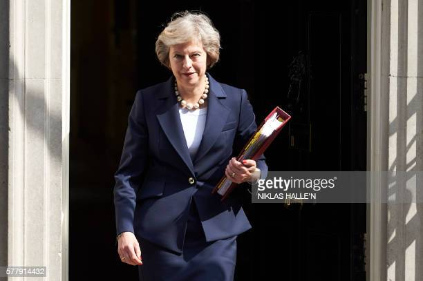 TOPSHOT British Prime Minister Theresa May leaves 10 Downing street in London on July 20 2016 on her way to the House of Commons to face her first...