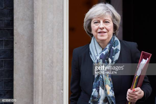 British Prime Minister Theresa May leaves 10 Downing Street in London on November 16 ahead of the weekly Prime Minister's Questions in the House of...