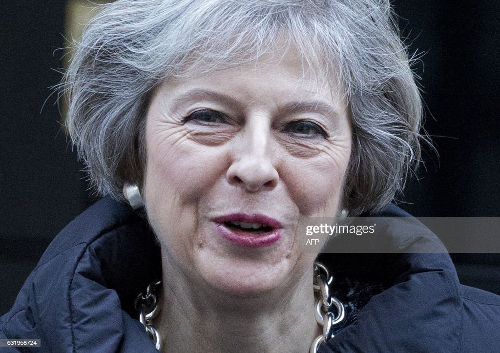 British Prime Minister Theresa May leaves 10 Downing Street in central London, on January 18, 2017, before attending the weekly Prime Minister's Questions (PMQs) at the House of Commons. British business leaders welcomed May on her Brexit clarity, following her speech yesterday, but insisted the UK prime minister must deliver on her pledge to secure access to the EU single market. / AFP / Isabel INFANTES