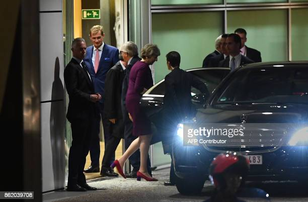 British Prime Minister Theresa May leaves after a meeting at the European Commission in Brussels on October 16 2017 European Union leaders meeting in...