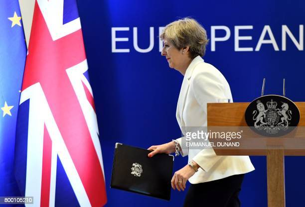 British Prime Minister Theresa May leaves after addressing a press conference at the end of a European Council meeting on the second day of a summit...