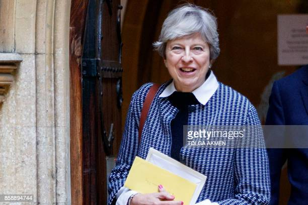British Prime Minister Theresa May leaves after attending the Sunday morning service at a church in her Maidenhead constituency in Berkshire east of...