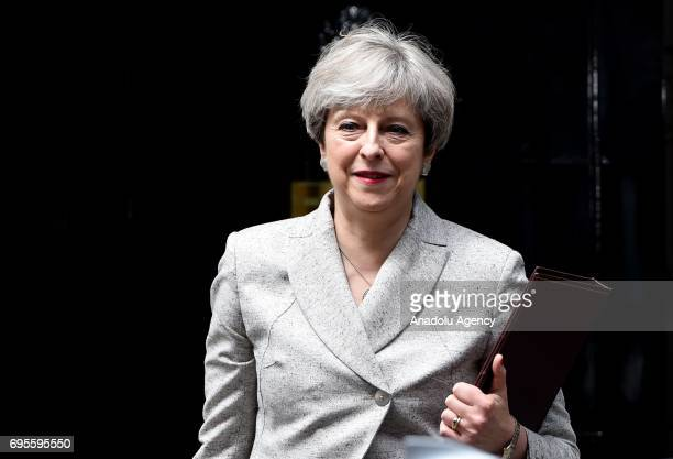 British Prime Minister Theresa May leaves after meeting Democratic Unionist Party leader Arlene Foster at 10 Downing Street in London United Kingdom...