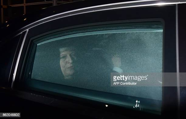 British Prime Minister Theresa May leaves after meeting the European Commission president at the European Commission in Brussels on October 16 2017...
