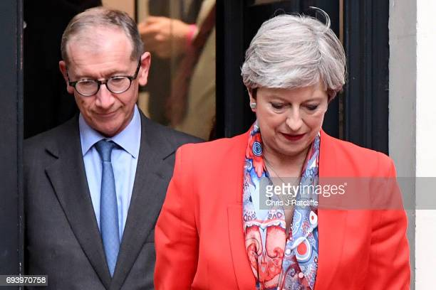 British Prime Minister Theresa May leaves Conservative Party Headquaters with her husband Philip on June 9 2017 in London England After a snap...