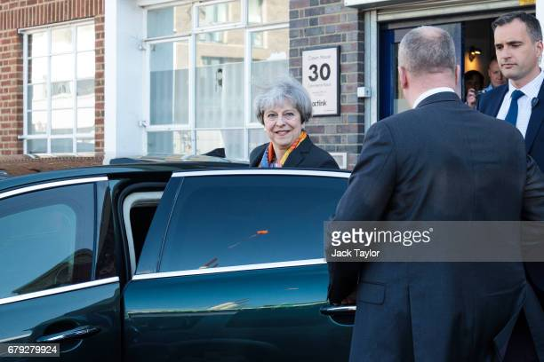 British Prime Minister Theresa May leaves following a tour of the Octink sign manufacturers' factory on May 5 2017 in Brentford England The...