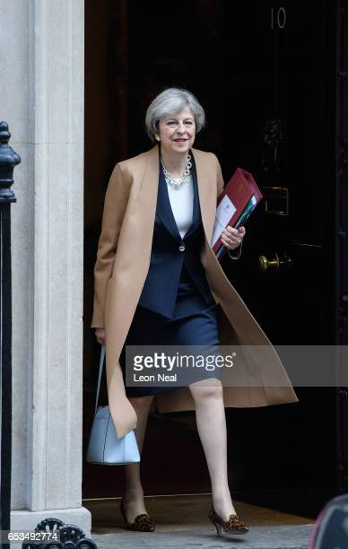 British Prime Minister Theresa May leaves number 10 Downing Street ahead of the weekly PMQ session in the House of Commons on March 15 2017 in London...