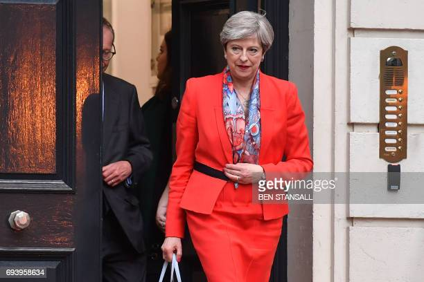 TOPSHOT British Prime Minister Theresa May leaves the Conservative Party HQ in central London on June 9 hours after the polls closed in the British...