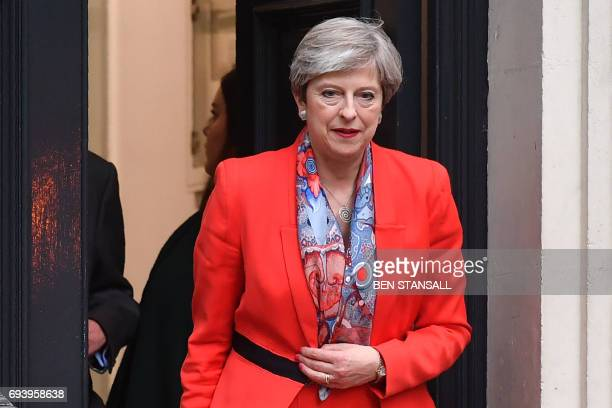 British Prime Minister Theresa May leaves the Conservative Party HQ in central London on June 9 hours after the polls closed in the British general...