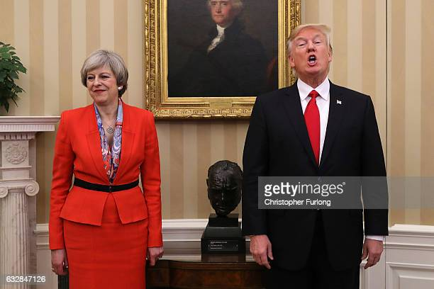 British Prime Minister Theresa May looks on as US President Donald Trump speaks in The Oval Office at The White House on January 27 2017 in...