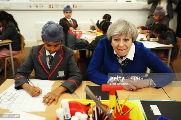 British Prime Minister Theresa May meets Akaal Singh a pupil of Nishkam Primary School on May 16 2017 in Birmingham United Kingdom Nishkam Primary...